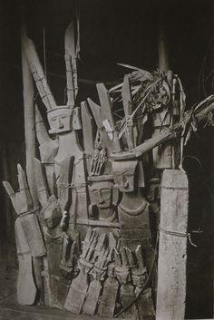 Dr Paul Wirz (1892-1955)    Idols of wood and stone in a House of Nias    From his Book: 'Nias, Die Insel der Götzen'. Ed. Orell Füssli Verlag, Zürich und Leipzig, 1929