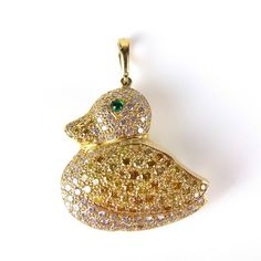 Yellow gold diamond duckling pendant. Yellow gold diamond duckling pendant. Set with white and yellow round brilliant cut diamonds and an emerald eye, the reverse of openwork design pierced with heart, moon and star shapes. Drop length 32 mm. Weight 6.1 grams.