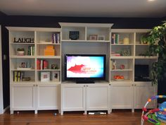 Crown molding built in entertainment center, wall bookshelves, built in boo Ikea Hack Bookcase, Besta Hack, Bookshelves Built In, Built Ins, Custom Bookshelves, Bookcases, Built In Entertainment Center, Entertainment Room, Ikea Hacks