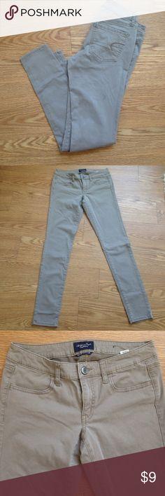 Tan American eagle skinny jeans Tan American eagle skinny jeans. Super stretch. American Eagle Outfitters Jeans Skinny