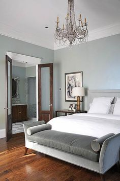 Modern Style The gray-blue hue also works well in contemporary settings. In this bedroom, white moldings and bedding and dark-stained wood floors are neutral complements to the gray-blue walls. Gray Bedroom, Trendy Bedroom, Bedroom Colors, Home Decor Bedroom, Bedroom Ideas, Bedroom Makeovers, Design Bedroom, Bedroom Bed, Master Suite Bedroom