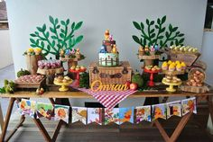 Dessert Table - Rustic Winnie the Pooh 1st birthday party via Kara's Party Ideas