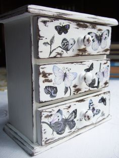 Rustic, Cottage chic, jewelry box, lilac, blue, black butterflies, decoupaged pretty little chest of drawers. $50.00, via Etsy. This in large would be beautiful