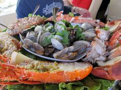 Enjoy a delicious mariscada in the coastal town of Sesimbra on a Customized Food & Drink Adventure - An American In Portugal Tours