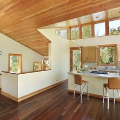 example of knotty pine ceiling, adjacent drywall and windows with pine trim