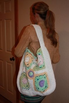 """Step back in time with this over sized Granny Square handbag and new trendy design.  It is quite large: 17"""" X 17"""". Could be used for a school bag, large purse, diaper bag or overnight tote. Colors: snow white, cool mint, antique yellow and deep purple. The bag is lined as shown in picture and has two inner pockets.It lays comfortably over the shoulder and softly against the body.  No matter what you use the bag for, you"""