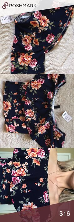 Off the shoulder cute floral crop shirt Navy blue floral shirt off shoulders if wanted to style like that  size M but runs more to size S. Cropped but not so cropped covers my belly a lot. Never used. Still has tags! Windsor Tops Crop Tops