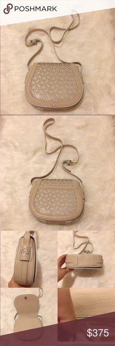 """Tory Burch Fret T Saddle Bag Brand new never used SOLD OUT !!  NWOT Tory Burch Fret T small saddle bag!  Color is light oak. In two-tone, laser-cut leather, Tory Burch's so-now saddle bag offers a graphic, statement-making look. Adjustable crossbody strap Snap flap closure; lined Exterior slip pocket, interior slip pocket, interior zip pocket 7.75""""L x 2.6""""W x 6""""H; 23"""" strap drop Leather Imported No trades. OPEN TO ALL REASONABLE OFFERS‼️ JUST NEED IT GONE Tory Burch Bags Crossbody Bags"""