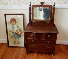 """19thC child's 3 drawer pine dresser with mounted mirror plus c. 1893 print """"A JOLLY LOT"""". Dresser is 21""""Tx22""""Wx12""""D. Mirror is 16.5""""T. Framed print is 29.5""""Tx15.5""""W."""