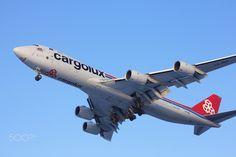 Boeing 747-8 Cargolux - NOVOSIBIRSK - JAN. 16: Boeing 747-8 Cargolux landing at Novosibirsk Tolmachevo Airport. January 16, 2016 in Novosibirsk Russia