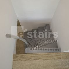 The top view of a 1m2 staircase with steel handrail and anti-slip caps in a stairwell with parquet floor.