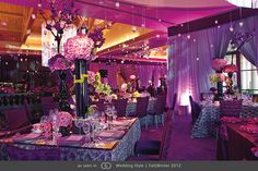 Contemporary décor complete with mirrored elements, eggplant carpet, floral taffeta linens, black vases and a collection of jewel toned centerpieces set beneath fringed lampshades. @grace_ormonde @wedding_style