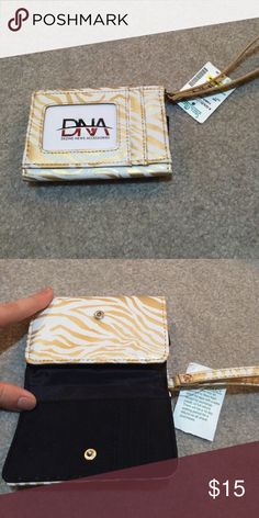 DeZine News Accessories wallet that fits a phone. Brand new with tags Bags