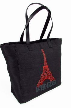 KENZO. Eiffel Tote Bag.  Black PVC - Eiffel - tote from Kenzo featuring an internal zipped pocket - two calf leather top handles and a contrast Eiffel Tower motif at the side. Dimensions - 34 x 16 x 33 cm.  Eiffel Tote in PVC nero - poliestere e vachetta. Tasca interna con zip - due manici in pelle di vitello. Dimensioni - 34 x 16 x 33 cm.