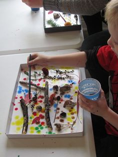 "Nature shadow boxes - objects from nature in gluey box lids ("",)"