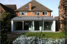 glazed doors and zinc roof at silvermead road House Windows, House Roof, Porch Extension, Extension Ideas, Home Roof Design, Metal Roof Houses, Zinc Roof, Kitchen Diner Extension, Outdoor Buildings