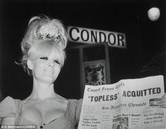 Carol Doda shows off the headlines in front of the Condor after a victory against city officials in 1965