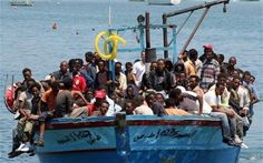 Would-be immigrants arrive on a boat in the port of Italy's southern island of Lampedusa