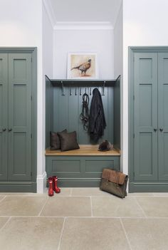 "Country Style casual boot room with stone floor. For a similar color try Zoffany's new "" Taylors Grey "" or "" Aubusson """