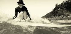 .black and white surfer