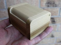 A handmade wooden box for storing rings and other small jewelry. Made of poplar. Rick Smith