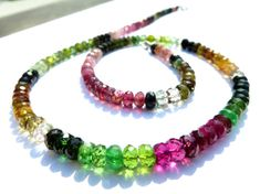 Faceted multicolor tourmaline necklace with a diameter of 5mm. The stones are clear and bright in color gradient from pink, green and cognac colored . The closure is a lobster clasp made of 925 Sterling Silver rhodium plated. Rhodium plated silver discolor not to black The Tourmaline