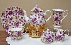 Pansy Chintz Bone China Tea Set   Imported from England with gold plated tea pot warmer