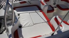 Bayliner Element XL: This entire area can be made into a sun pad with the addition of a pair of filler cushions that easily fit into the storage underneath the starboard seat.
