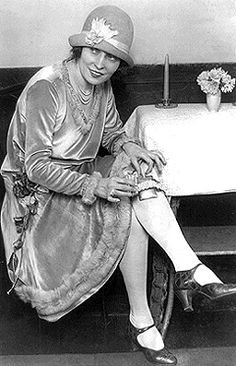 With the advent of short skirts in the 20s, garters were a necessity to the feminine costume; they were made of frilly ribbons, ruffles and jeweled clasps. What could be more convenient than attaching a little glass bottle to the ribboned or jeweled clasp?    Of course there were those flappers who just tucked their flask under the elastic band!