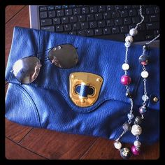 Urban Expression blue clutch!! Blue vegan leather clutch! Super cute. Only flaw is scratching from the front latch on the gold hardware. Not noticeable when closed! Ask any questions! Urban Expressions Bags Clutches & Wristlets