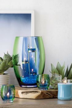 Artisan blown glass hurricane is awash in the vibrant shades of spring – the vivid green of fresh grass, the bright blue of the morning sky. Color is applied by hand for a unique and beautiful work of art. Add a pillar or jar candle for a spectacular glow. Find yours at PartyLite.com.