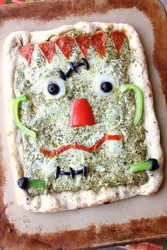 Frankenstein pesto pizza.  Super cute and a spin on traditional pizzas.