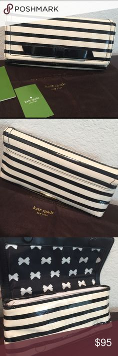 Kate Spade Clutch Keira Chelsea Park Patent Stripe Beautiful and Elegant Clutch from Kate Spade New York Keira Chelsea Park Patent Stripe • Color: Black/Cream • Fabric Custom Lining • Exterior: Black Bow in front and Gold Accent Kate Spade Logo on the back •  Interior: 6 Credit Card Slots kate spade Bags Clutches & Wristlets