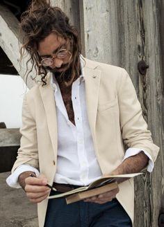 #1 Roman's House Outfit: Unkempt ponytail. Glasses. Unbuttoned, wrinkled shirt but untucked. Old suit coat. Slacks or pants.