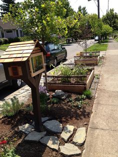 curbside (that's a little free library on the left)