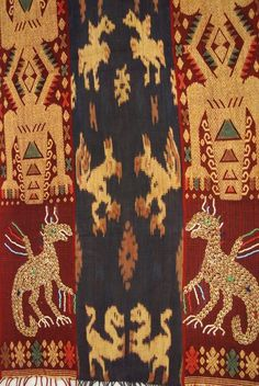 Hand spun Hand woven, with tiny Nassa Shells sewn in, in the shape of  mythical animals, Sumba Hinggi Warp Ikat Tapestry Waeo Songket, rare collectable. Offered by Asmatcollection on ebay or bonanza.com cheetahdmr@aol.com