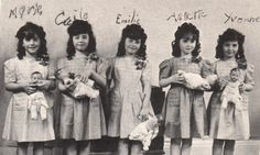 "The Dionne quintuplets holding their own ""Dionne"" dolls"