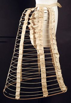 This is a cage Crinoline. This garment is dated 1870 and found at the MET. The crinoline cage was much more comfortable and lighter than garments from earlier time periods. Victorian Era Fashion, 1870s Fashion, Victorian Costume, Vintage Fashion, Belle Epoque, Vintage Outfits, Manequin, Mode Costume, Bustle Dress