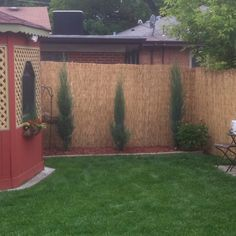 Reed fencing. Doubled for extra privacy. Put up to existing fence with zip ties.