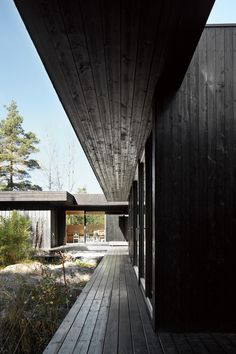 """Sævik compares her house to a contemplative hideout. """"It's very quiet,"""" she says. """"You can concentrate and let thoughts fly."""" Her favorite summer pastimes include reading, painting, drawing, yoga, and """"just sitting and feeling the forest,"""" she says."""