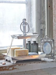 Love this silver tray used as a bathroom tidy