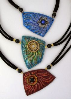 Necklaces by HELEN BREIL | Polymer Clay Planet [like the way these are strung and the added embellishment on top]
