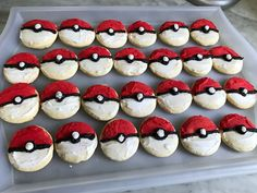 Sugar cookies frosted to look like Poke Balls as a snack for a Pokémon-themed birthday party. Click or visit FabEveryday.com to see details and DIY instructions for a Pokémon or Pokémon Go themed kid's party, including food, decorations, favors, and party activities.