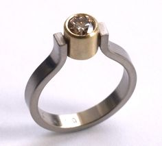 Champagne Diamond Ring, White & Yellow Gold. (great design for my diamond out of my wedding ring!)
