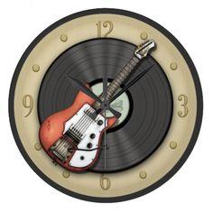 Vintage Guitar and Vinyl Record Wall Clock http://www.zazzle.com/vintage_guitar_and_vinyl_record_wall_clock-256934340833855114?rf=238909315443825159