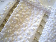 White on white embroidery by Karen Ruane.  French knot