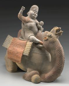 Tang Dynasty ( tomb earthenware of a Turkic caravan woman rousing her camel while nursing. What an illustration of the ethnic interactions and women's role. Terracota, The Han Dynasty, Asian History, Ancient China, Ancient Artifacts, Ancient Civilizations, Chinese Art, Ancient History, Asian Art