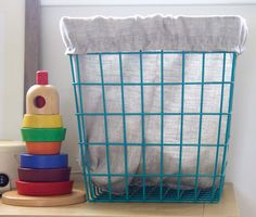 Baskets are essential to keeping your baby's nursery organized. Spruce up the room and your storage baskets and make custom DIY fabric basket liners!