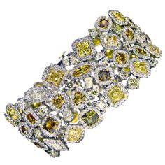 Magnificent Fancy Intense Color Diamond Bracelet | From a unique collection of vintage charm bracelets at http://www.1stdibs.com/jewelry/bracelets/charm-bracelets/