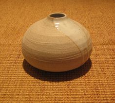 I love the spilt glaze look on the still raw bisque ware.  I wonder if I could do this on a coil pot...